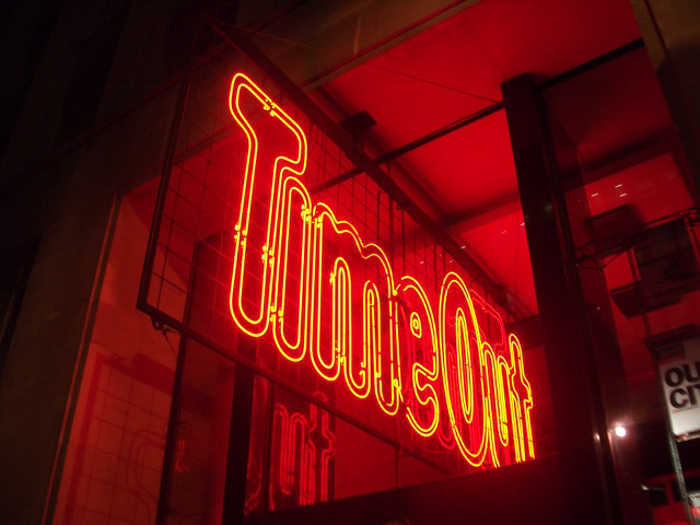 Red neon Time Out sign shown in a frame
