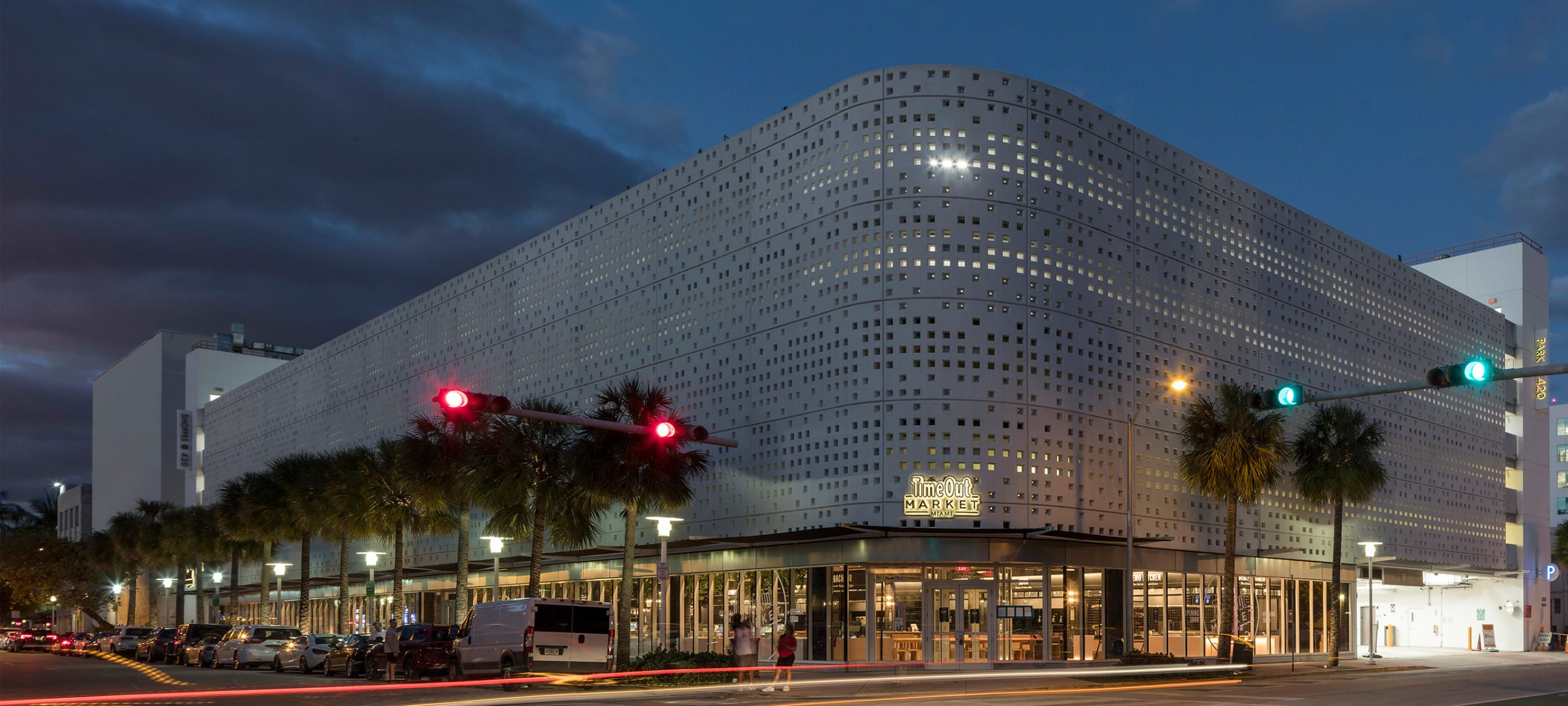 Time Out Market Miami building lit up at night