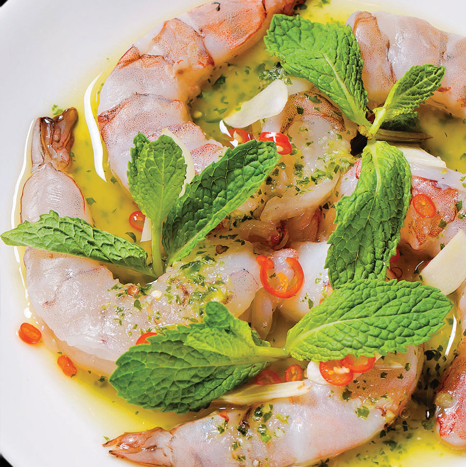 Shrimp and Thai chili dish with fresh herbs by Fish Cheeks