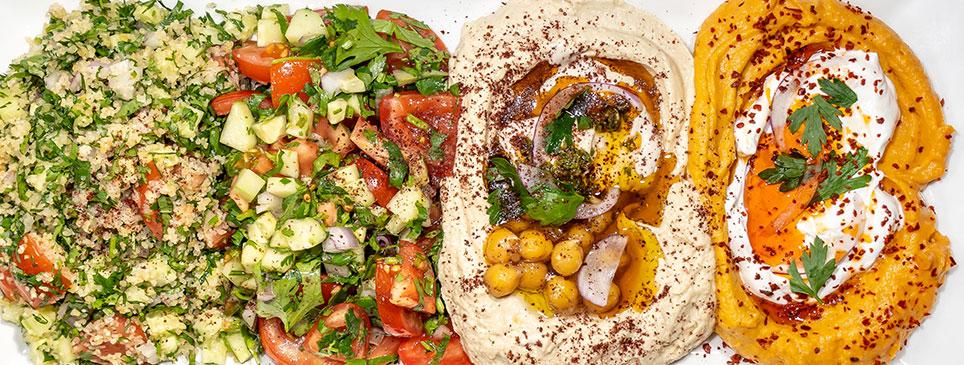 Hummus and Israeli salad mezze platter by Little Ada