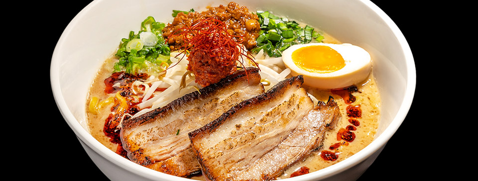 Bowl of pork belly ramen with an egg by Mr Taka